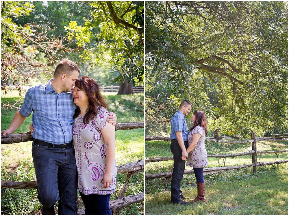 A couple embraces near a wooden fence during their engagement portraits at Brazos Bluffs Ranch in Waco, Texas - Jason & Melaina Photography, www.jasonandmelaina.com