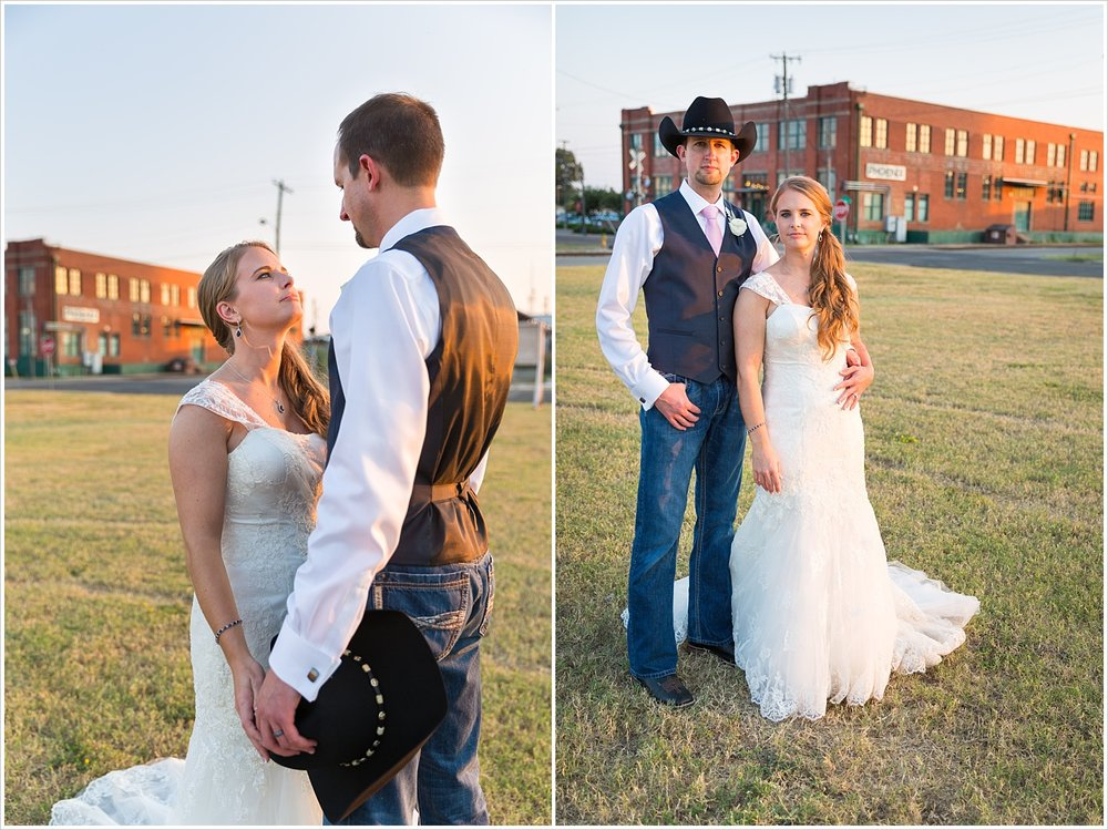 A bride and her cowboy groom pose stoically outside The Phoenix, Navy and blush Texas Reception at The Phoenix Ballroom, Jason & Melaina Photography - www.jasonandmelaina.com