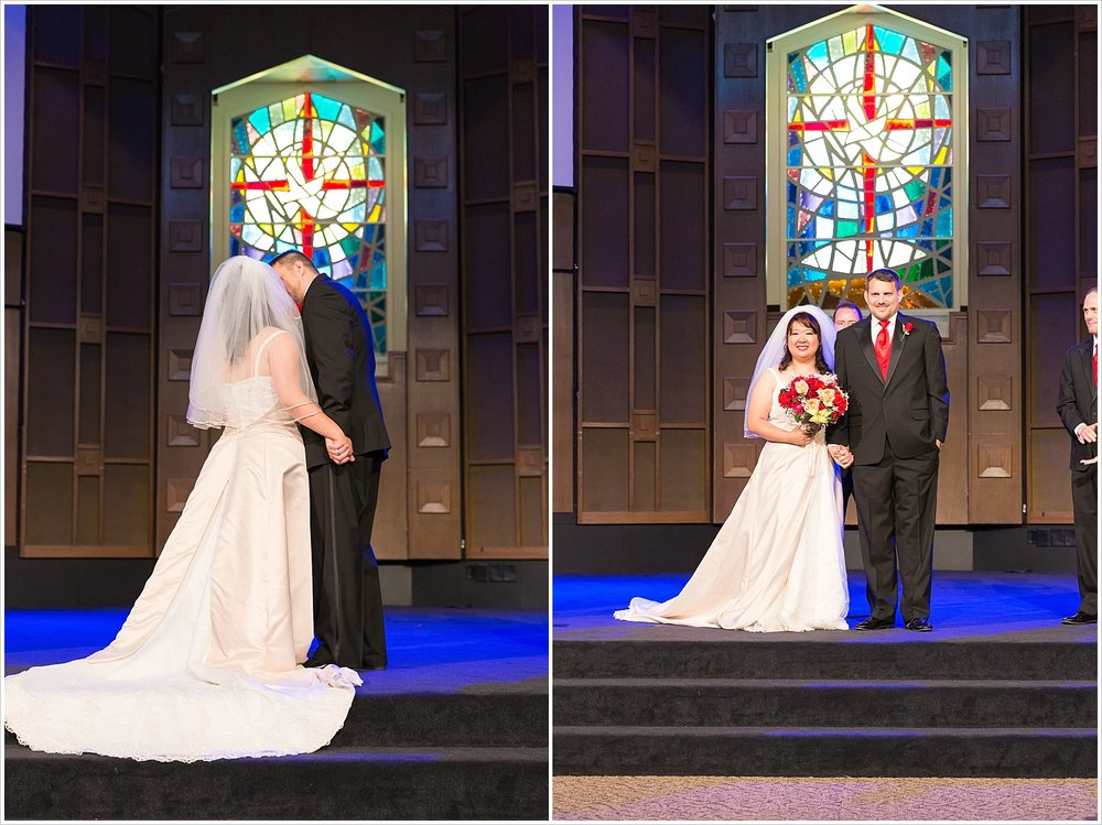 Groom kisses his bride in front of stained glass window, traditional church wedding, Waco, Texas - Jason & Melaina Photography, www.jasonandmelaina.com