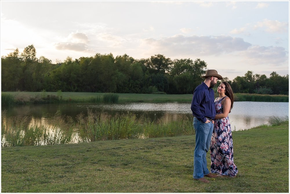 Couple during an engagement shoot posing by pond at Brazos Park East, Waco, Texas, Jason & Melaina Photography - www.jasonandmelaina.com