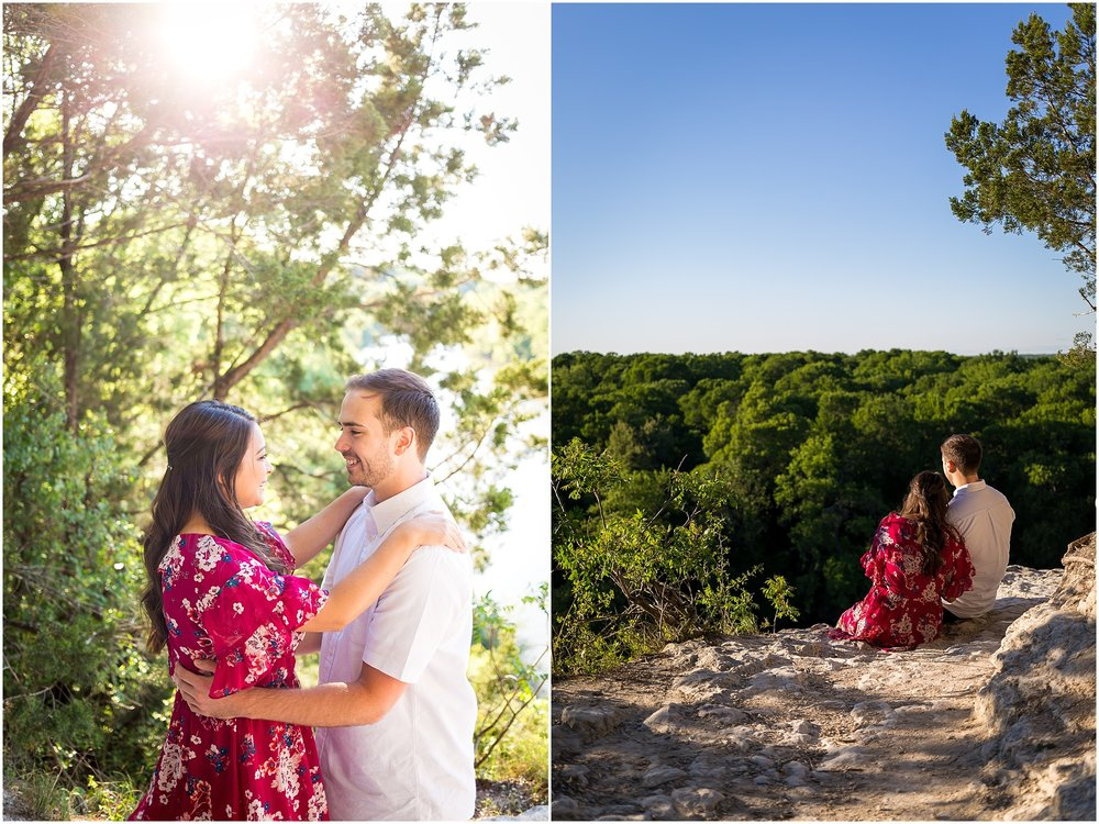 An engaged couple sits on a cliff in Cameron Park during their engagement photo session