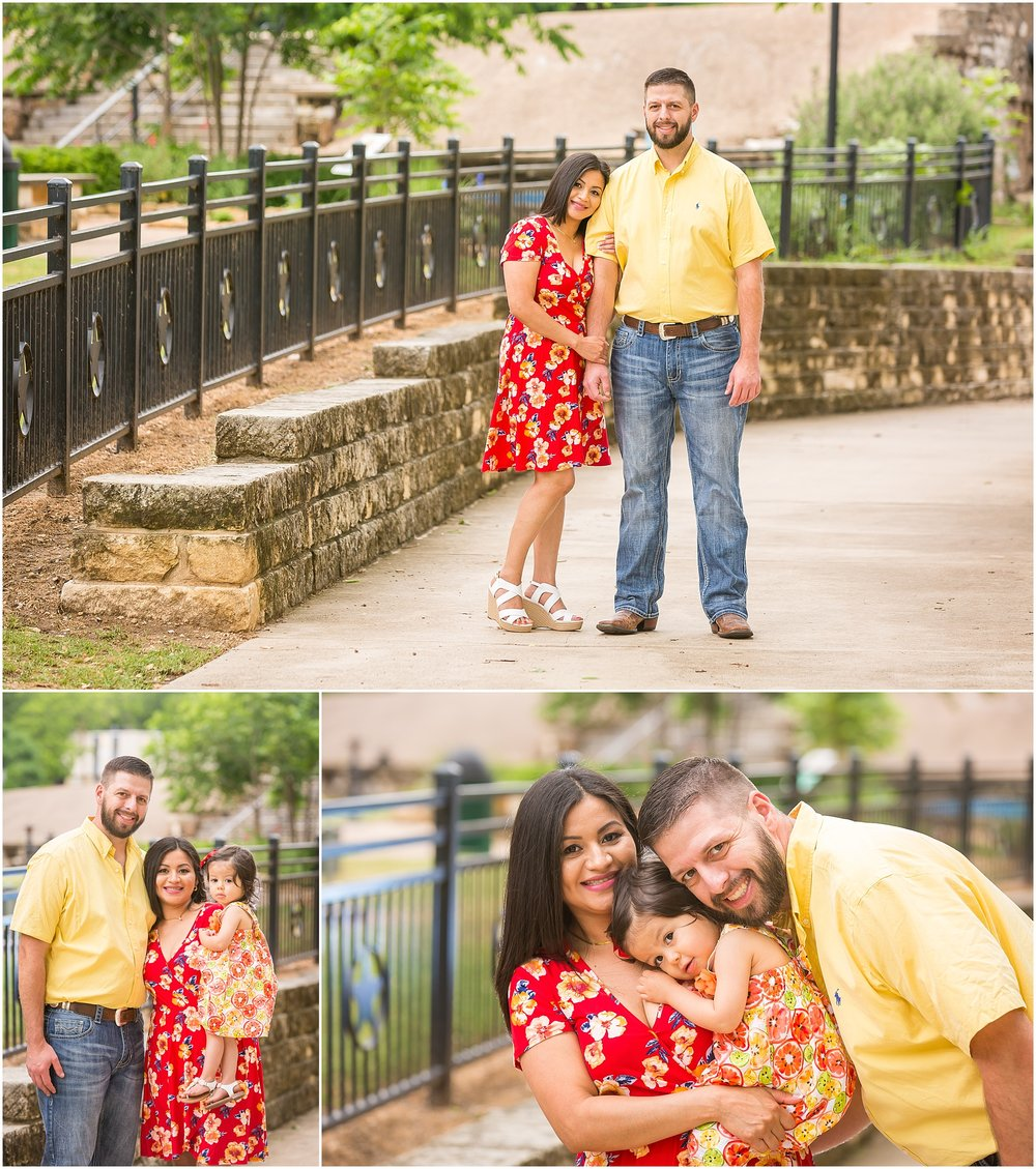 A couple holds their young daughter during their engagement session in Belton, Texas