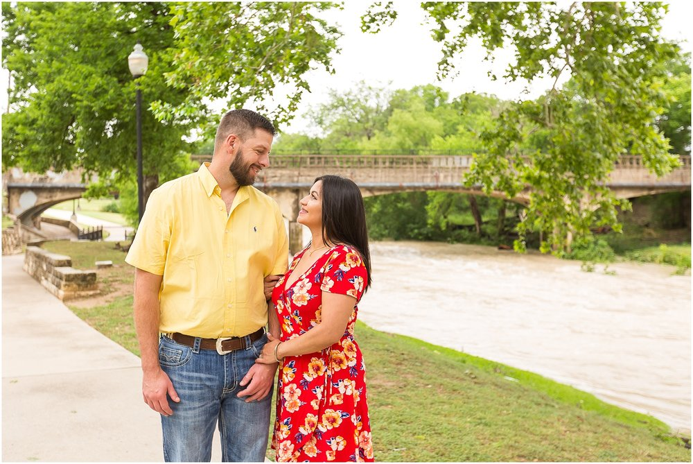 Couple embraces and looks at one another by a river in Belton, Texas