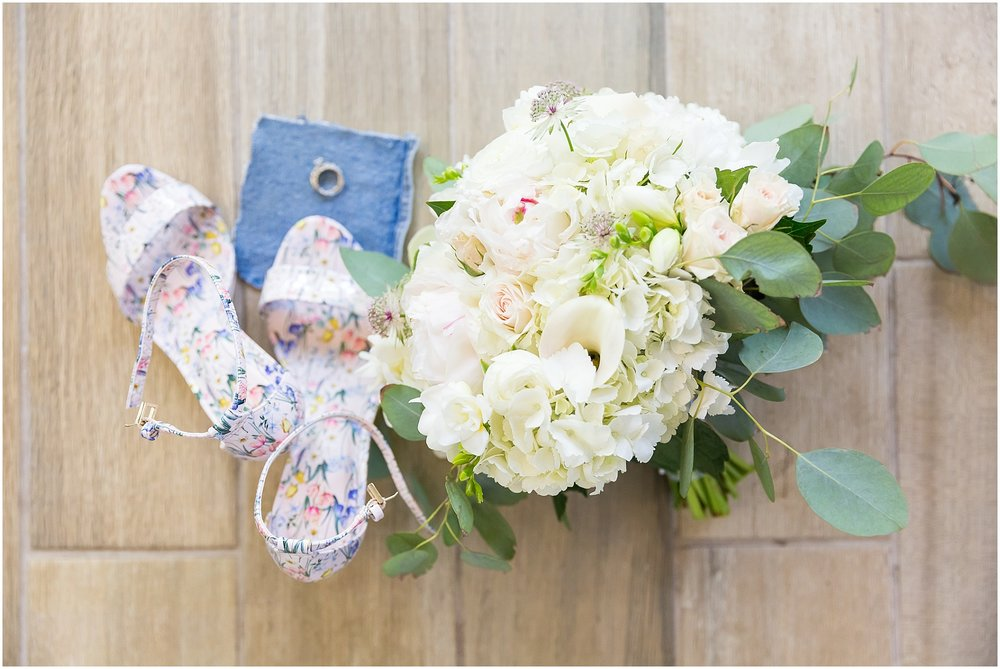 Bride's floral heels and bouquet at Fixer Upper house in Waco, Texas - www.jasonandmelaina.com