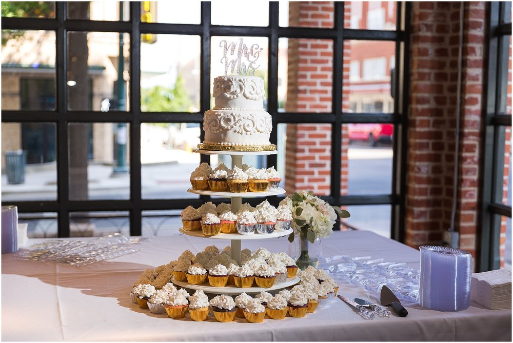 Cake and cupcake display at a warehouse wedding in Waco, Texas - www.jasonandmelaina.com