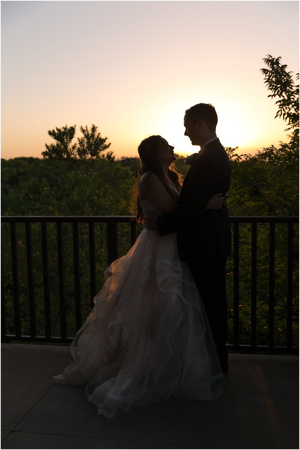 A bride and groom silhouetted by the Texas sunset at their summer wedding in Waco, Texas - Jason & Melaina Photography - www.jasonandmelaina.com