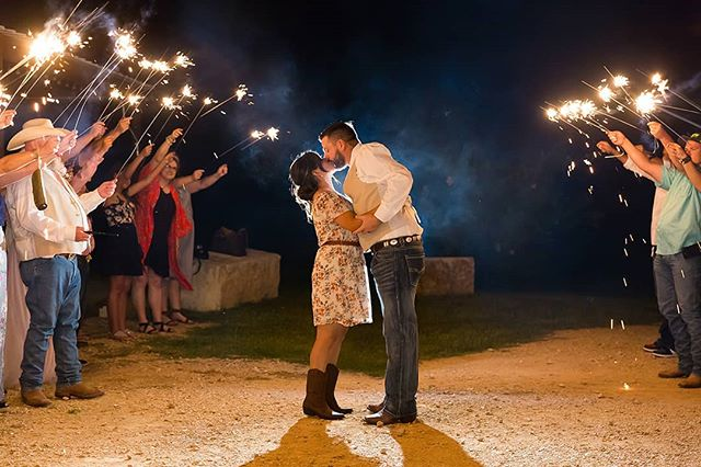 Anatomy of a sparkler exit- ✨ 1 couple in love, leaving to start their new life together ✨ A group of friends and family cheering them on and waving sparklers, hopefully standing back far enough if they've been having a really good time at the reception ✨ 1 photographer holding a flash to be edited out later when her foot is in the shot ✨ And the results are the perfect end to the perfect day. 💏 Double tap if you love sparkler exits at wedding. ❤ Or if you like a different type of exit better, let us know below! 👇