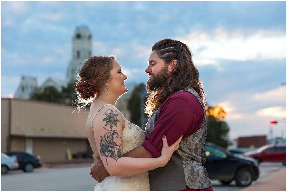 Groom holds his bride in town square in Hillsboro, Texas - Jason & Melaina Photography - http://jasonandmelaina.com