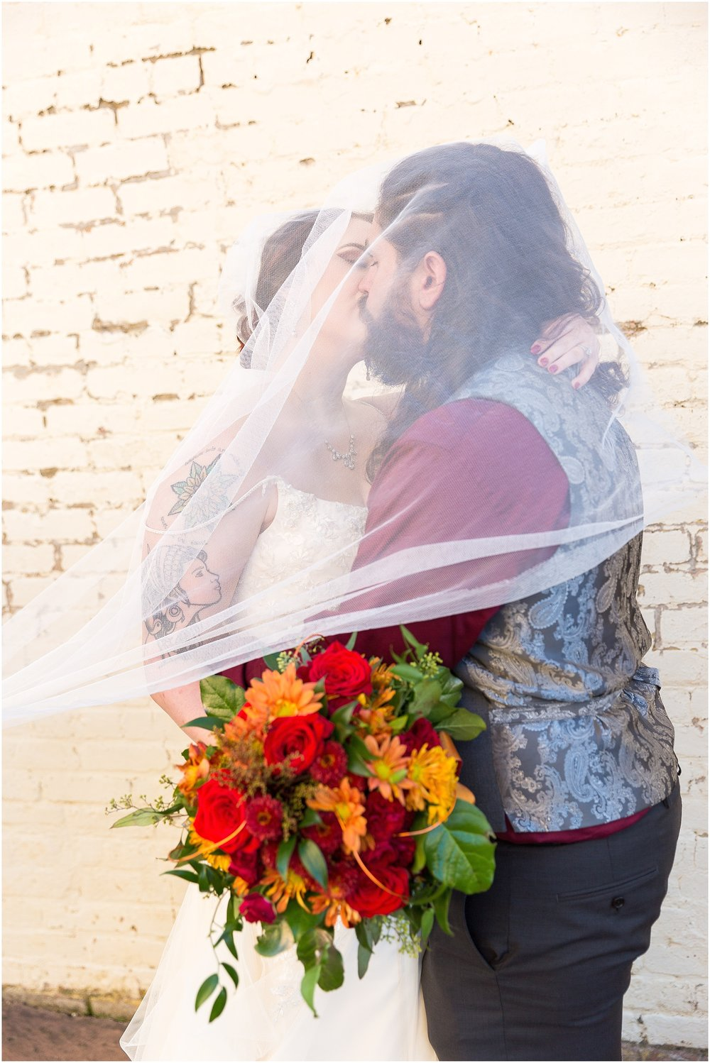 Bride and groom kiss under veil - Jason & Melaina Photography - http://jasonandmelaina.com
