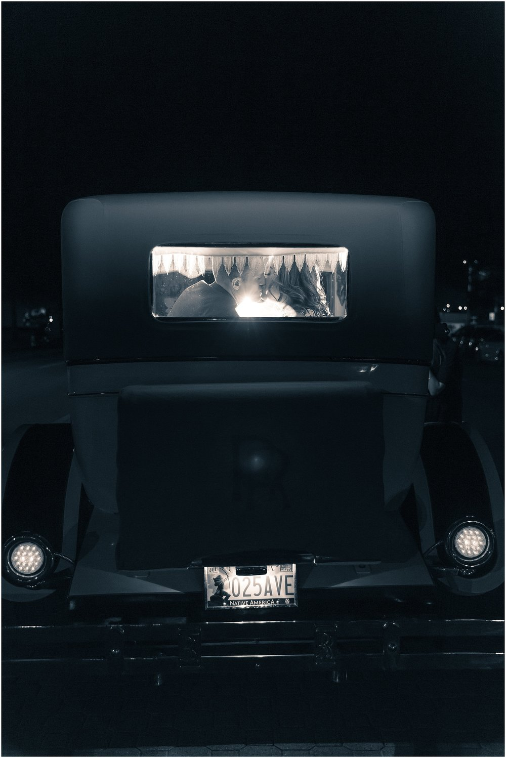 Bride & Groom kiss in the back of their Rolls Royce getaway car after their wedding at The Hippodrome, Waco, Texas - Jason & Melaina Photography - www.jasonandmelaina.com
