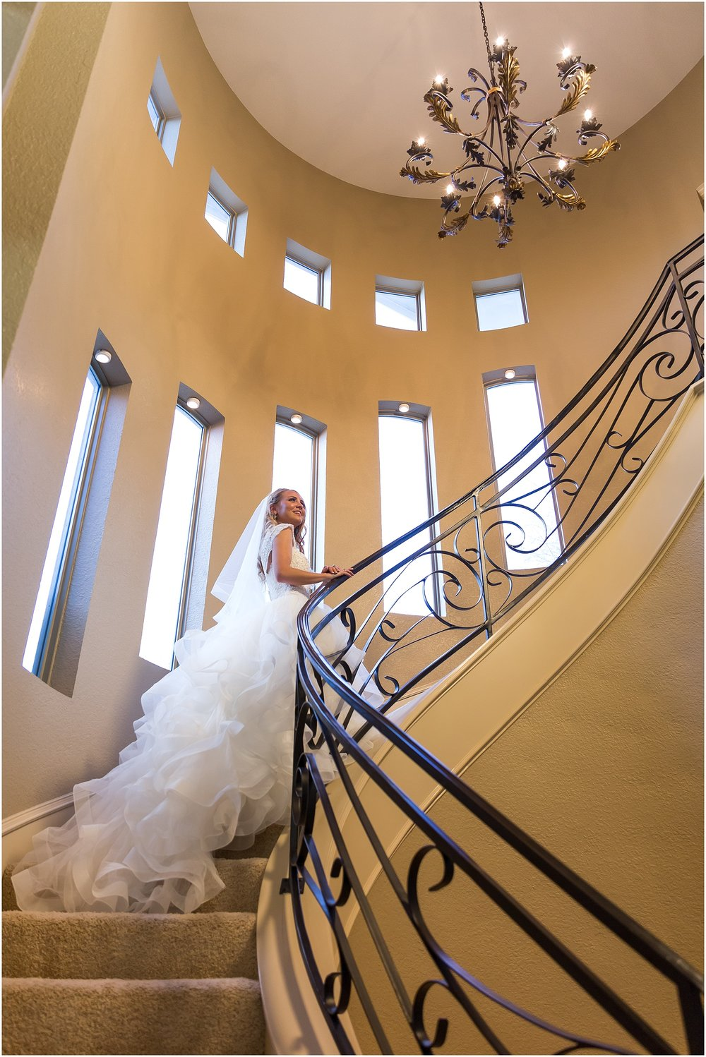 Bride poses on winding staircase - Jason & Melaina Photography - www.jasonandmelaina.com