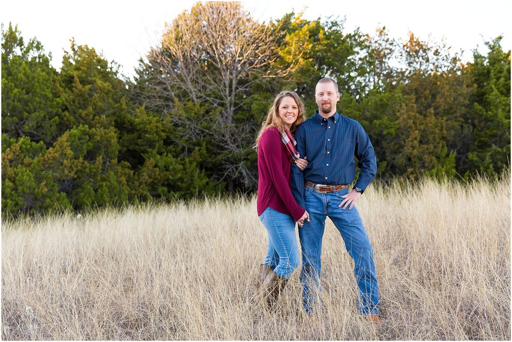 Couple holds one another in field of tall grass - Waco, Texas