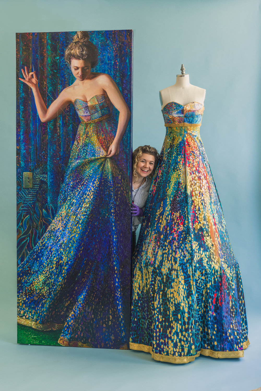 z_with-dress-and-self-portrait-on-blue-backdrop.jpg