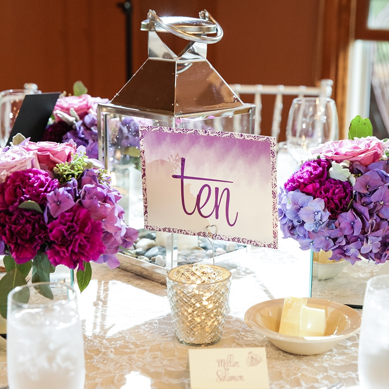 Pink Umbrella Designs - Wedding Table Number. Photo by Cassie's Camera