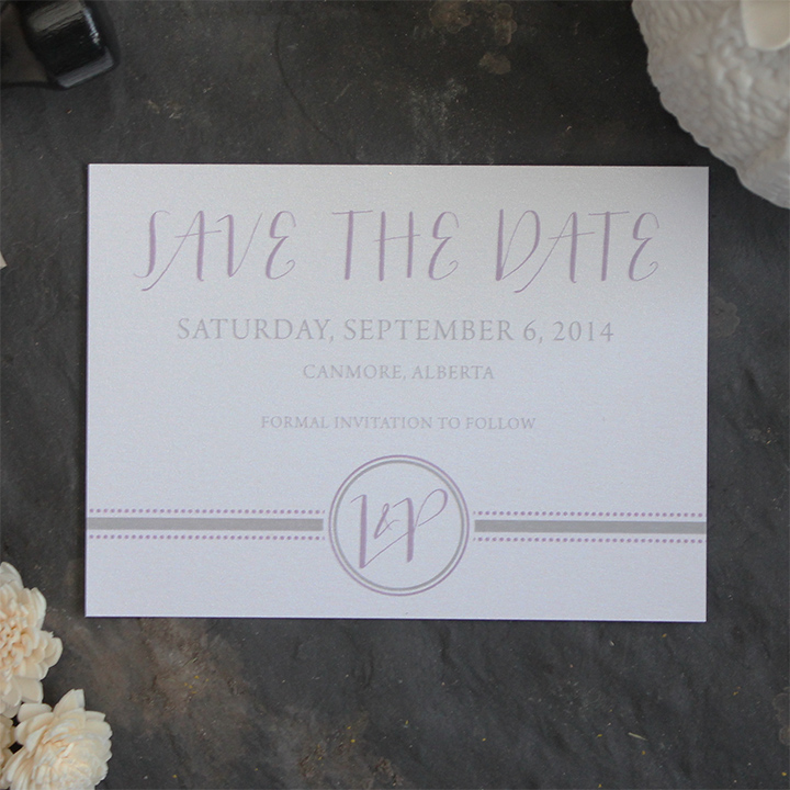Modern and elegant monogram save the date invitation.