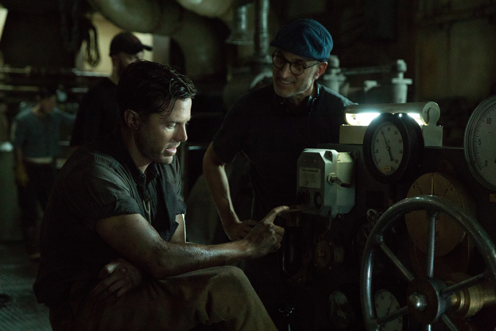 Casey Affleck as 'Ray Sybert' with director Craig Gillespie on the set of 'The Finest Hours.' photo courtesy of Disney.
