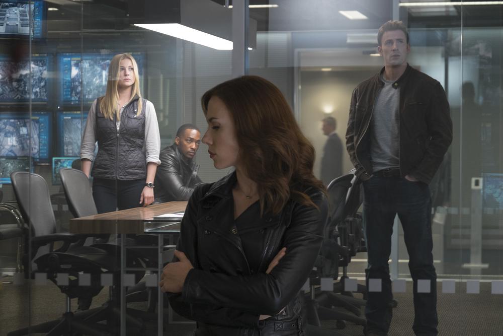 Emily Van Camp (Sharon Carter / Agent 13), Anthony Mackie (Sam Wilson / Falcon), Scarlett Johansson (Natasha Romanova / Black Widow), Chris Evans (Steve Rogers / Captain America). Photo courtesy of Marvel