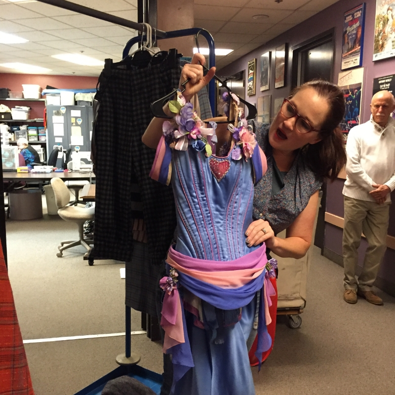 Gillian Austin shows us the detailing in the costumes. Backstage at SCFTA. photo Marta Darby