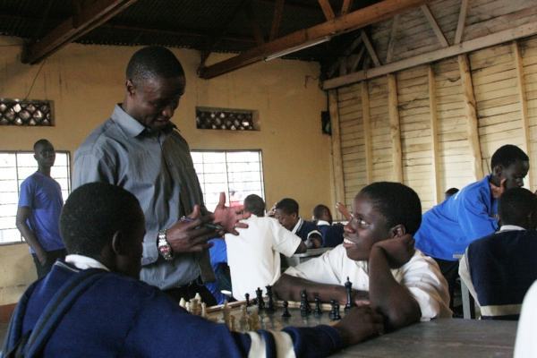 Robert Katende and his chess students. Photo courtesy of Disney® - all rights reserved