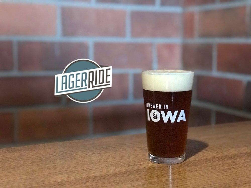 "Our easy drinking  Red Lager  is named after the Adventureland Log Ride  (""Lager Ride"")  whose timbers make up our deck. Sweet crystal and caramel malts bring out an inviting drinkable lager.  5.5% ABV - 14.4 IBUs"