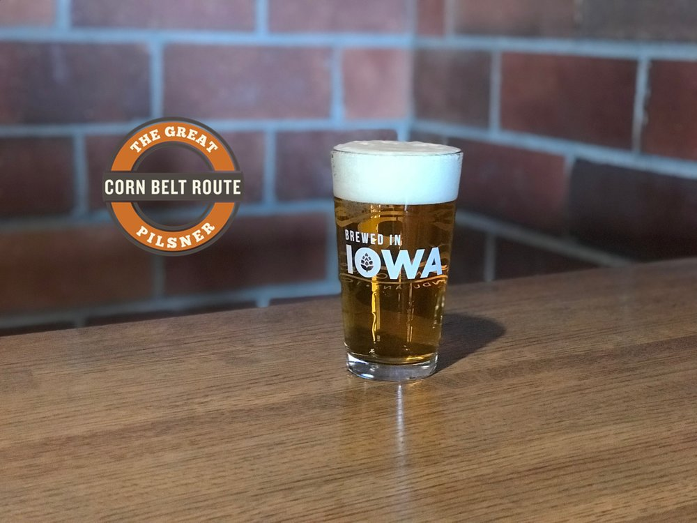 Our  Corn Belt Pilsner  is a crisp german style with a cleansing hop finish. Imported continental pilsner malt and all German hops make this an authentic brew.  5.2% ABV - 23 IBUs