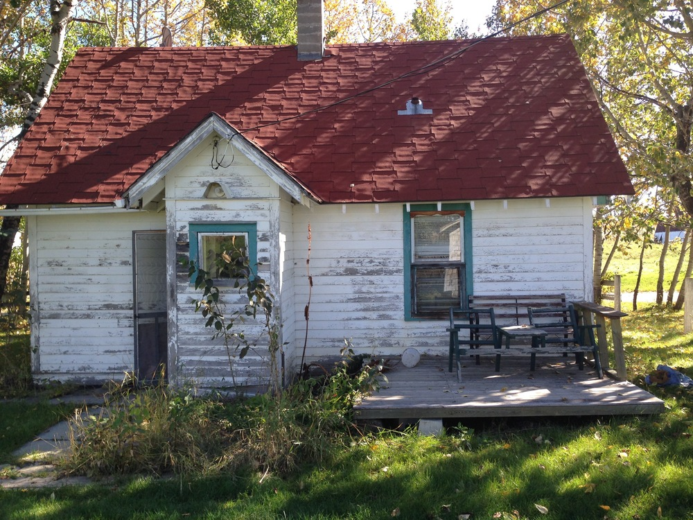 Before: Exterior of Cottage