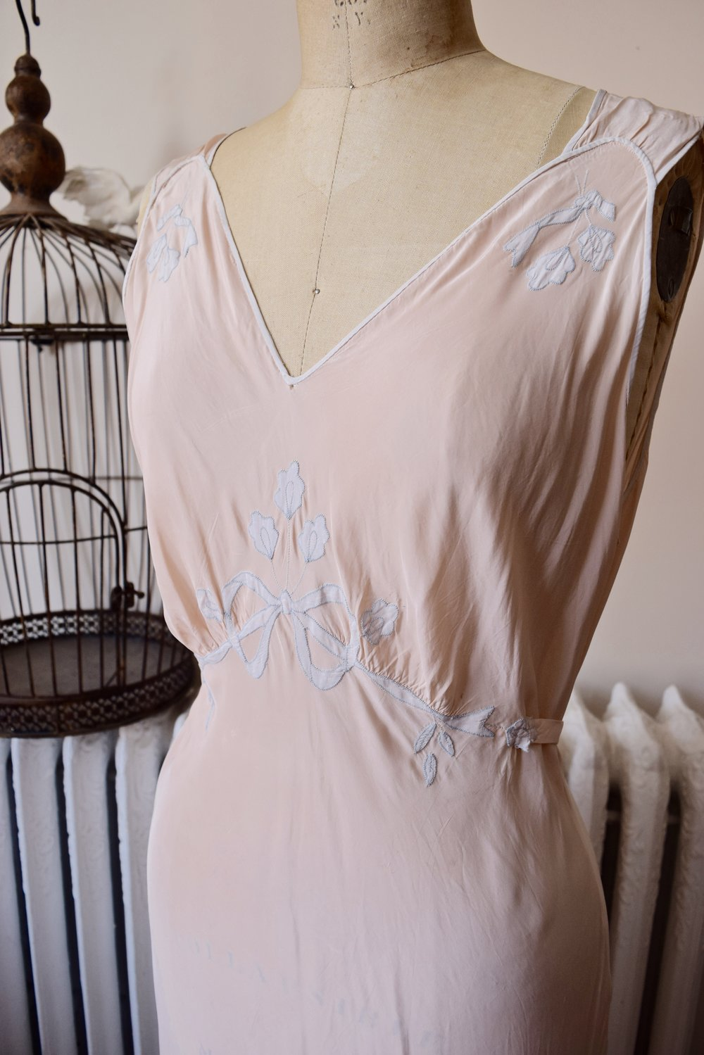 Pandora- 1930's long peachy-pink bias cut gown.