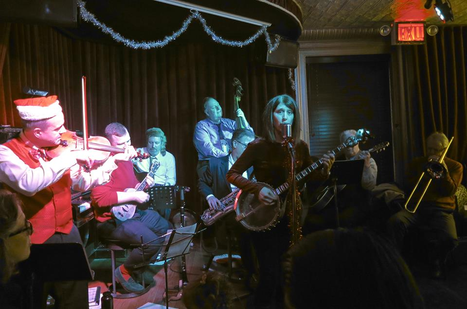 """Cynthia Sayer leads the gang and Jim Wildman, trombone,through """"Benny's From Heaven"""" at the Red Room holiday show, December 10th, 2017."""