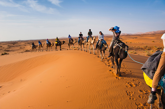 Tourists on a camel ride in Erg Chebbi Desert, Sahara Desert nea