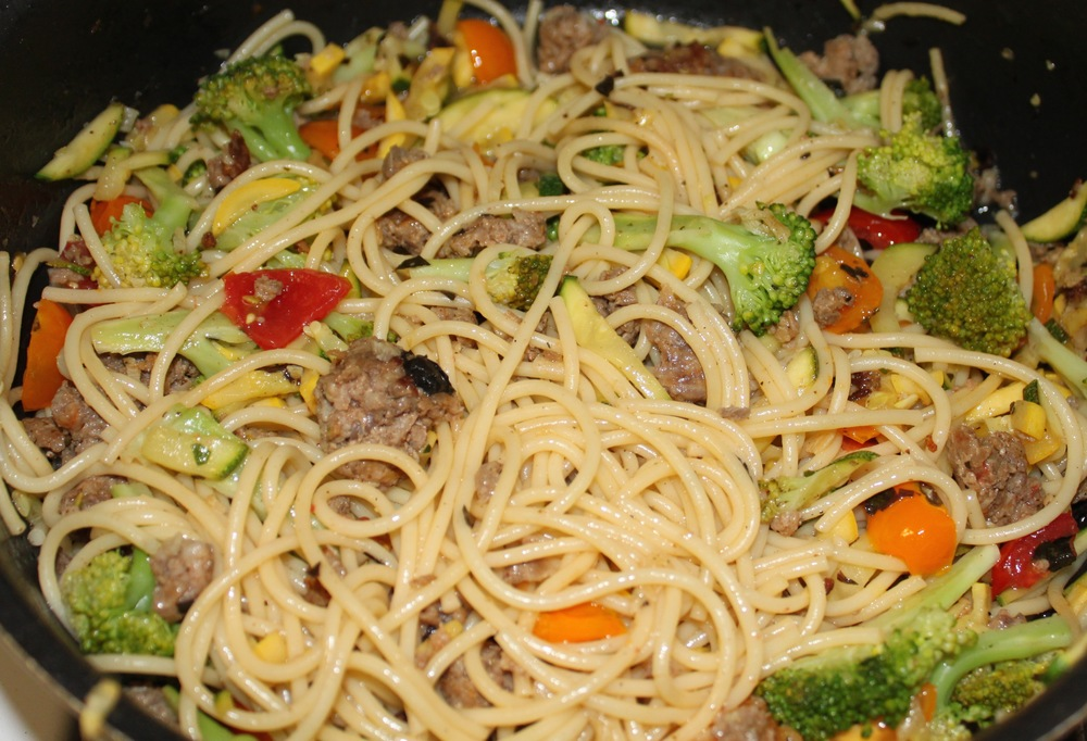 Pasta with Italian Sausage, Squash, Broccoli, and Cherry Tomatoes.
