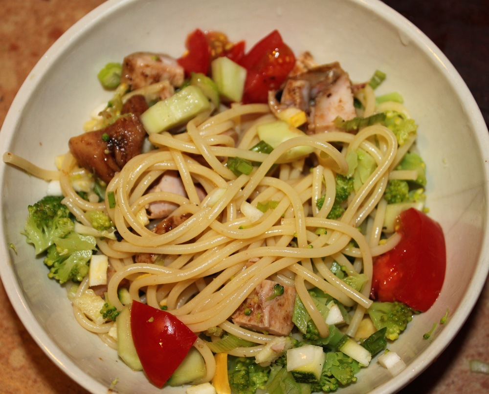 Pasta Salad with Barbecue Chicken, Chopped Broccoli, Squash, Cucumbers, and Cherry Tomatoes.