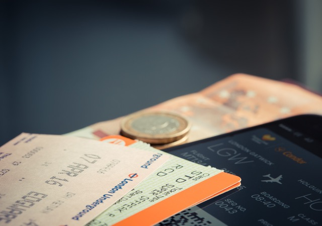 Plane ticket and currency