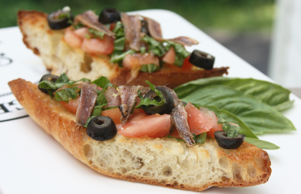 bruschetta anchovy tomato olives bread snack appetizer