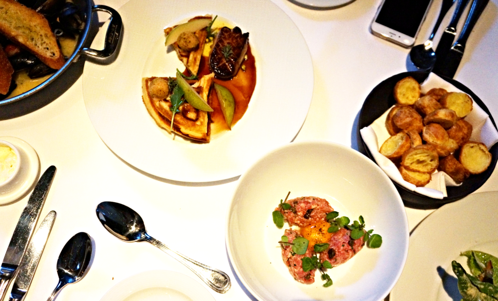 From left to right: Fisherman's Mussels, Hudson Valley Foie Gras,Steak Tartare, Caesar Salad