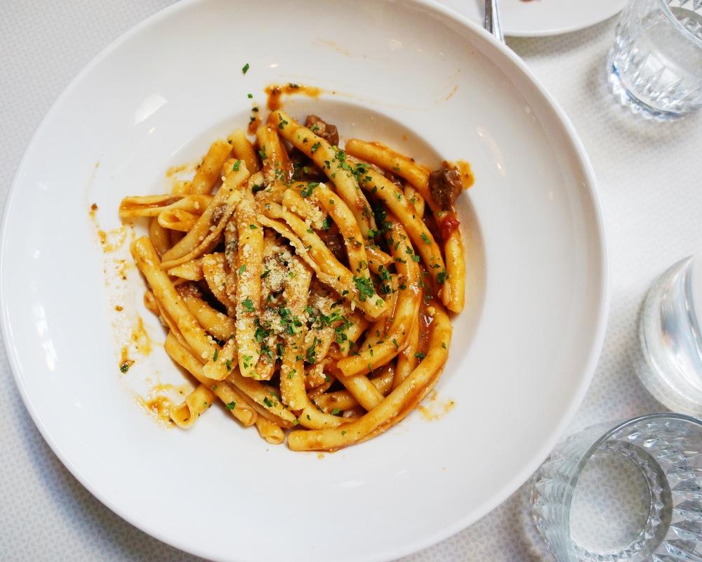 Strozzapreti $17(Homemade pasta, braised beef, onions, parmigiano, herbs, tomato)