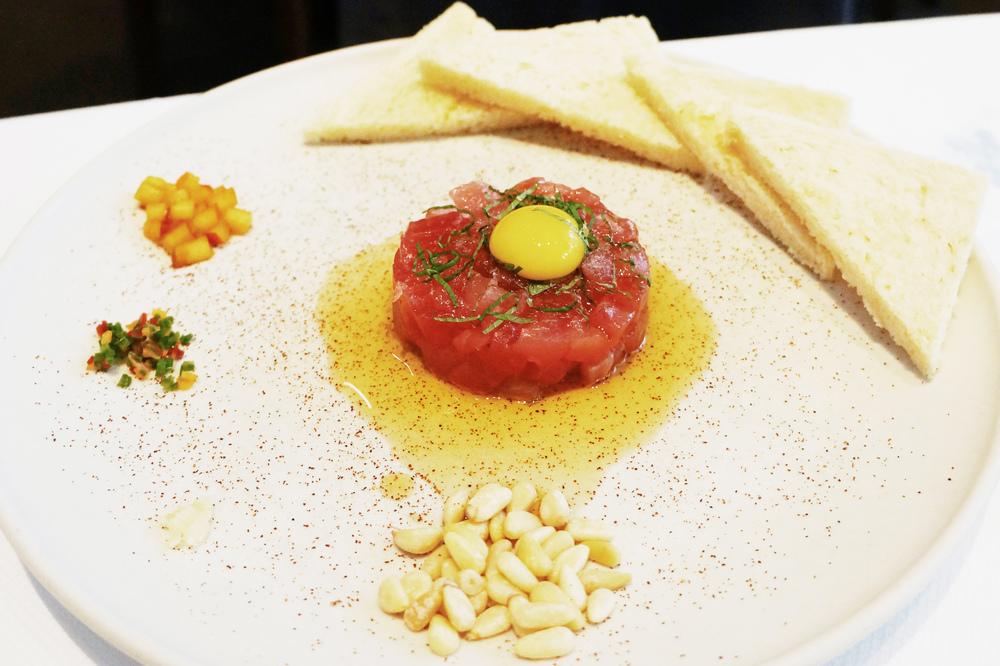 Ahi Tuna Tartare(habanero-infused sesame oil, pine nut, quail egg yolk) $20