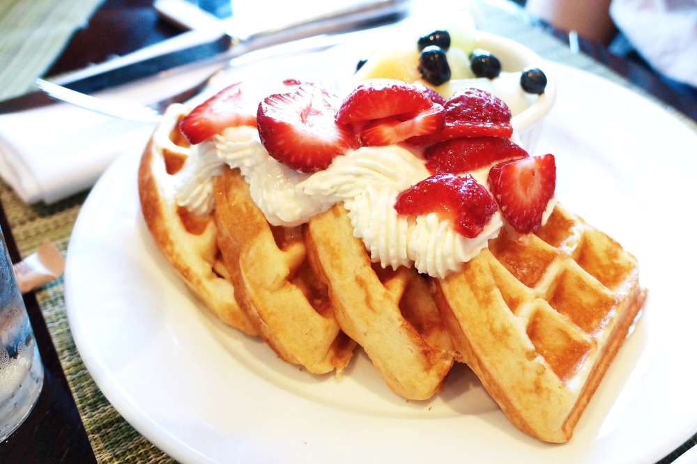 Buttermilk Waffle with side of fruit and whipped cream $11