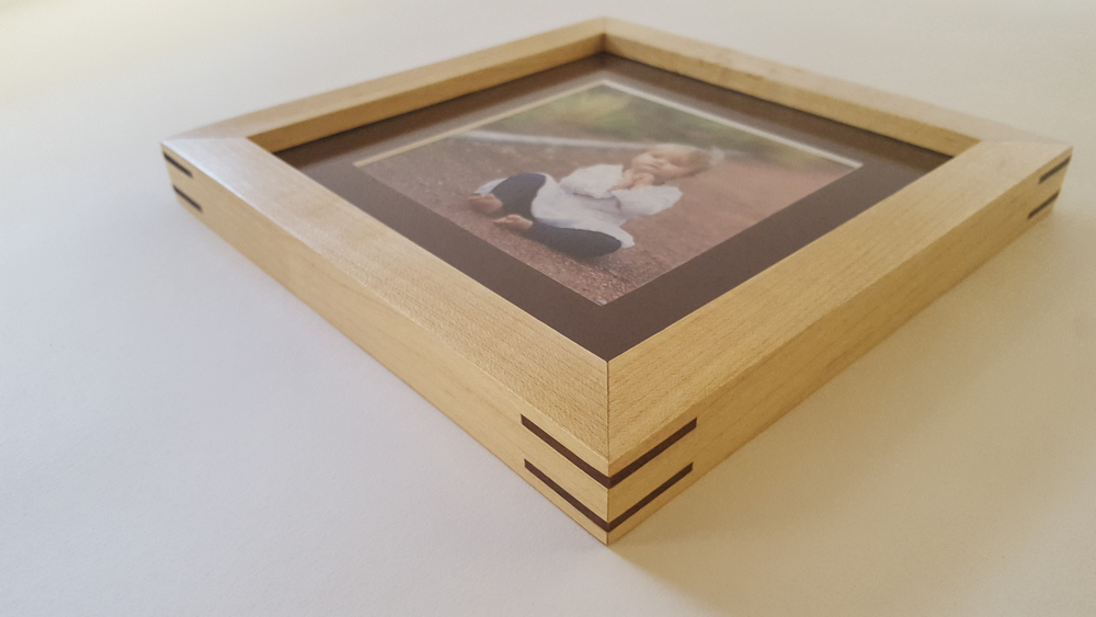 This is a maple frame with walnut splines