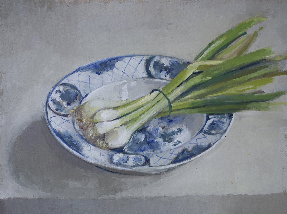 Spring onions in Delft bowl