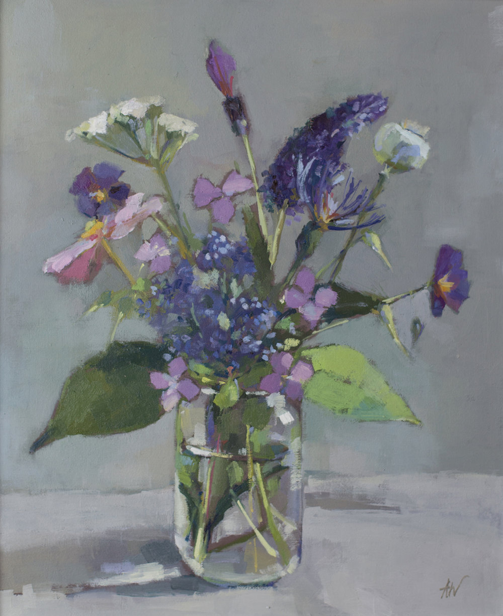 Purple flowers in jam jar