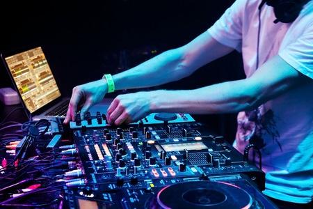 Alt< Dj mixes the track in the nightclub 450 Width x 300 Height.jpg