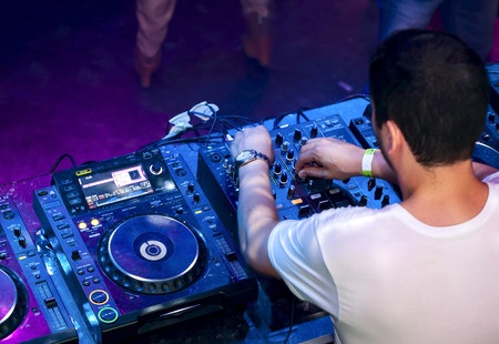 Dj mixes the track in the nightclub 450 Width x 310 Height.jpg