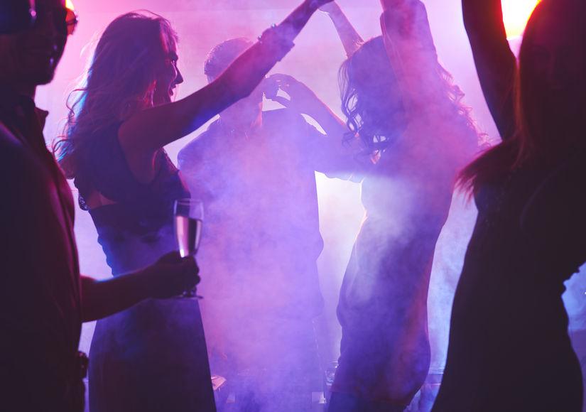 DJ with girls dancing - 825 Width x 580 Height.jpg