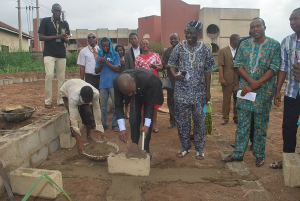 Prof. Olukoya Ogen, Provost ACE, Ondo laying the foundation stone of the hostel in the presence of COEASU members 2.JPG