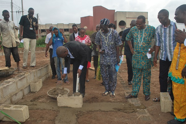 Prof. Olukoya Ogen, Provost ACE, Ondo laying the foundation stone of the hostel in the presence of COEASU members.JPG