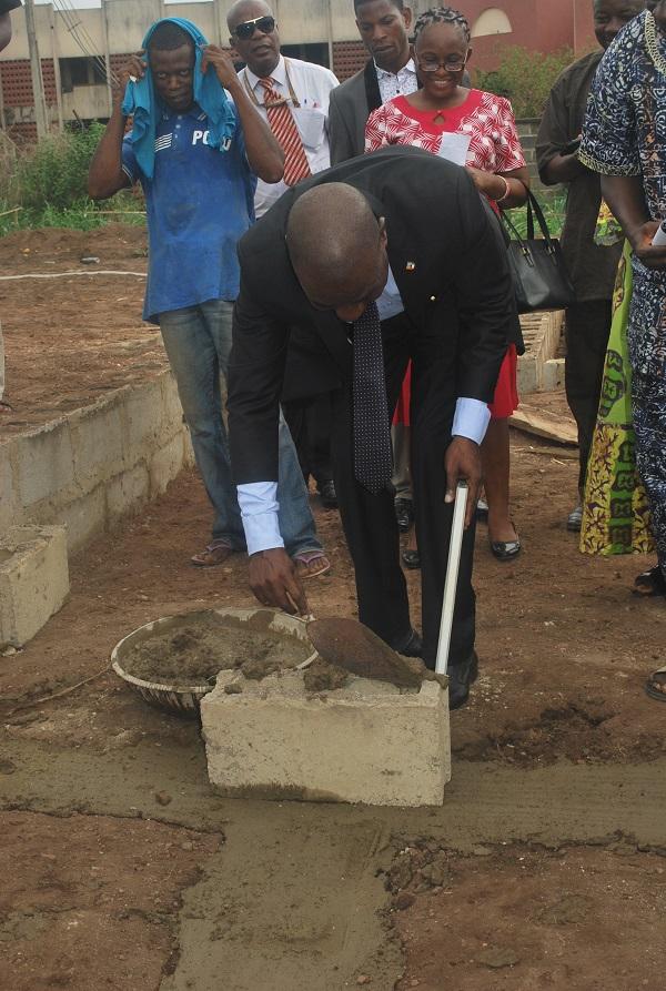 Prof. Olukoya Ogen, Provost ACE, Ondo laying the foundation stone of the hostel.JPG