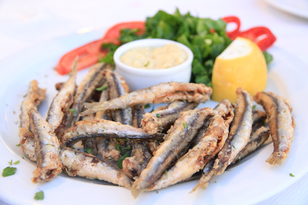 Delicious sardines, lightly fried in olive oil and drizzled with lemon