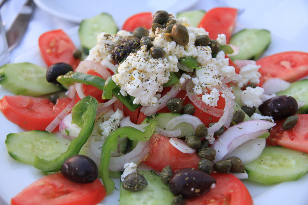 Traditional Greek salad drizzled with olive oil
