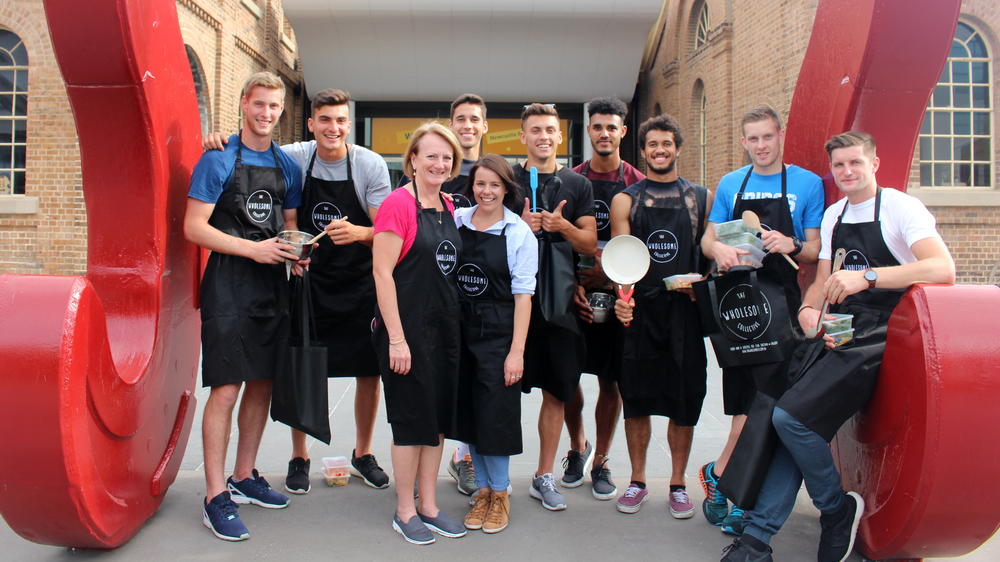 The young boys from the Newcastle Jets FC following an interactive nutrition and cooking presentation