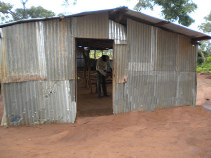 CLASSROOM OF DISCARDED IRON SHEETS.
